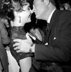 The Man Who Loved Four, Button Ones With Peaked Lapels. Mike Todd, with wife Elizabeth Taylor 2.