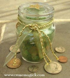 Money Spell Bottle Items needed:  5 old pennies  5 dimes  5 quarters  5 kernels of dried corn  5 sesame seeds  5 cinnamon sticks  5 cloves  5 whole allspice  5 pecans  Place each item into a thin, tall bottle, such as a spice bottle. Cap it tightly. Shake the bottle with your projective hand for five minutes while chanting these words:  Herbs and silver  Copper and grain  Work to increase My money gain    Place the bottle on a table in your house. Leave your purse/wallet near the bottle.