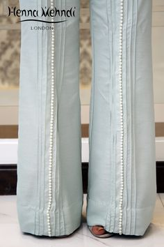 Light blue raw silk pearl embellished trousers. Available in trousers, cigarette trousers or boot cut trousers. Please note these are trousers only. These ca