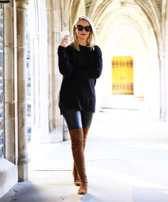 all black outfit with camel over the knee boots