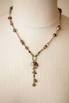 Handcrafted necklace is unique with its tassle focal cluster of gemstones