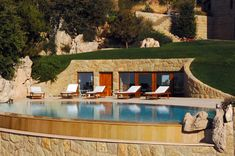 side hill house pool mediterranean with terrace traditional outdoor chaise cushions