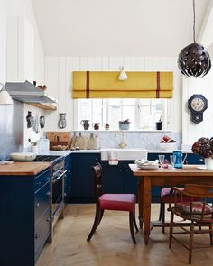 Good morning from @thelistbyhouseandgarden. It's takeover Wednesday and today we are focusing on our favourite kitchens designed by members of our online directory, #TheList. In this kitchen area, traditional and contemporary pieces work together and a mix of chairs around the dining table create an informal look. Carrara-marble-topped units are painted in 'Hague Blue' by @farrowandball, while a mustard blind from @susandeliss brings warmth to the space. Open-plan living is made cosy with…