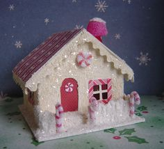 This red and white  Christmas village paper Peppermint house is made in the vintage putz style. Description from etsy.com. I searched for this on bing.com/images