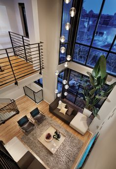 A two-story wall of windows brings the outdoors in. Designed by Douglas Burton of Apartment Zero and BOWA.