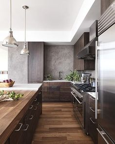 Modern industrial loft kitchen design. Hardwood. Wood countertop. Monochrome. Neutral. Home renovation inspiration idea.