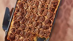 Extra cinnamon-swirl dough slices like cookie dough -- and becomes crisp and caramelized in the oven, much like palmiers. Bake it on a parchment-lined baking sheet until very golden, about 12 minutes. You'll be thankful you did at your morning coffee break. For the decorating technique, see our step-by-step photos.
