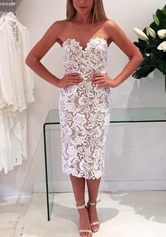 This white paisley lace sheath dress has sweetheart neckline with padded cups, back zipper and back slit detailing. | Lookbook Store