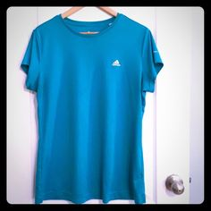 Adidas active top, turquoise, XL Aqua top with moisture-wicking. Great for working out. Clean and no tears or rips. Small stains from laundry detergent (see last photo.) Priced accordingly. XL. Adidas Tops