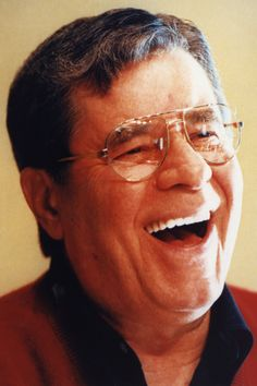 Jerry Lewis laughing/••••originally a part of the comedy duo with Dean Martin. Jerry was the funny man who took the falls and acted silly, Dean was the straight man, a singer and always got the girl. Split--reason unknown. Each worked independently. Jerry largely associated with Muscular Dystrophy drive at Labor Day.