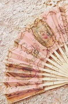 Ana Rosa. I remember sitting in church on a hot afternoon, fanning myself with a paper fan. They were a common sight before air conditioning.