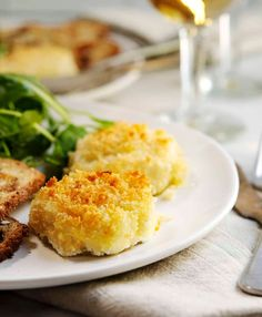 Crispy and golden brown outside, soft and warm inside, Baked Goat Cheese is a perfect appetizer or salad topper! One of those recipes you'll return to over and over for entertaining or as a way to turn a mixed salad into something spectacular. You need just 4 simple ingredients: a soft goat cheese log, panko bread crumbs, olive oil, and kosher salt!