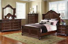 brown solid wood bedroom furniture wood flooring white bed cover have lampshade cream painted wall bedroom vanity