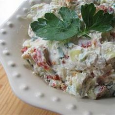Tuscan Cream Cheese Spread Recipe Appetizers with cream cheese, chopped garlic, salt, artichoke hearts, black olives, green onions, sun-dried tomatoes, chopped parsley, chopped fresh chives