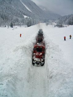 Plowing through snow in Rogers Pass, Glacier Park, B.C.