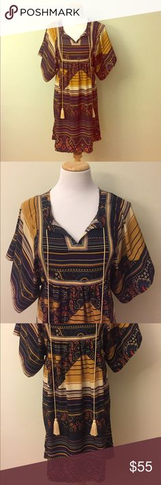 """NEW Ya Los Angeles Multi Colored Tunic Size L This is a brand NEW with tag Ya Los Angeles multi colored Tunic. Measurements: Bust 34""""; armpit to armpit laying flat 17""""; length 35"""". Ya Los Angeles Tops Tunics"""