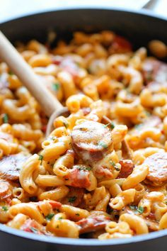 One Pot Andouille Sausage Skillet Pasta by damndelicous: This dish comes together so easily in one skillet. Even the pasta gets cooked right in the pan! #Pasta #Sausage #Fast #Easy