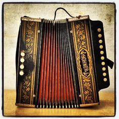 Vintage accordian.My grandfather learned how to play this instrument in Bulgaria and now it is displayed in my living room. Simply a breathtaking instrument!