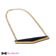 Black & gold necklace made of wooden tongue depressor.