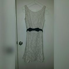 White house black market dress size 4 Beautiful dress. Cream lace with black detachable belt. Zips in back. Gently used. Cotton blend.  Lined.  Length 37 White House Black Market Dresses