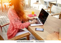 Cropped image of a female keyboarding on laptop computer with copy space screen…
