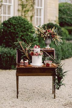 An antique writing desk is the perfect display for one dramatic cake like this one styled by The Flower Girls // www.onefabday.com