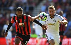 Lewis Grabban of AFC Bournemouth challenges for the ball with Luke Shaw of…