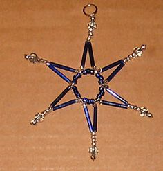 How to Make Beaded Star Tutorials - The Beading Gem's Journal. I used the instructions to make an 8-pointed star with 4 large arms and four small ones.