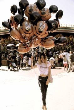 Living in the Moment at Disney Photo IDEA or Selfie with Holding Balloons + Disney Shirt (Optional).