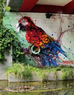 3D Street Art Graffiti: Colorful macaw parrot by Bordalo Segundo in Portugal.  the artist recycle street trash for his Installations. * creative * idea * ideas