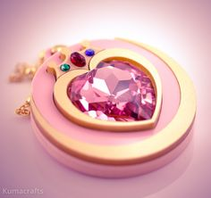 Moon Prism Power, Make Up!  This pendant was inspired by Chibiusa's first transformation brooch.  This pendant is crafted from multiple layers of light pink acrylic and gold acrylic.  The center of the pendant consists of a huge pink 28mm Swarovski crystal heart rhinestone! Staring at this crys...