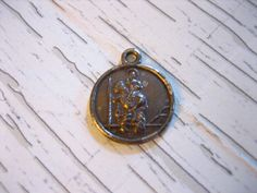 Christopher Charm or Pendant. Measures just over in diameter and marked Sterling. Saint Christopher, Pocket Watch, I Shop, Vintage Jewelry, Charmed, Sterling Silver, Pendant, Accessories, Etsy