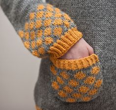 pumpkin + mid gray nice cuff, pocket and trim design tie-in prettyknitty:  Flickr - Photo Sharing!
