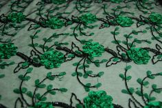 Black tulle with green embroidery, green ribbon flowers, black round sequins and bugle beads
