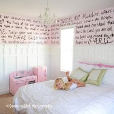 Love the idea of writing on the wall.  They used some text from the Madeline stories hand painted girl's bedroom to look fun and whimsical