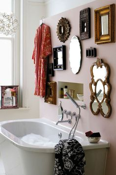 Love the robe hanging with the mirrors/knick knacks