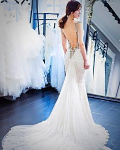 #Wedding #gowns are all about the back. See our queen Elizabeth... The back is entirely surrounded with hand beaded jewels creating cap a rose window and gothic roses pattern.  Thanks @monarca_couture