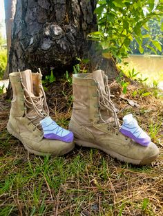 Baby girl booties with daddys army boots.