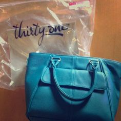 Thirty - One bag (never been used) Thirty-one purse.  Brand new, never used. Thirty-one Bags Shoulder Bags