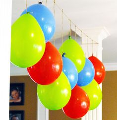 hang balloons upside down- cheaper. Google Image Result for http://www.polkadotdesign.org/storage/thumbnails/10988362-16873027-thumbnail.jpg%3F__SQUARESPACE_CACHEVERSION%3D1330522926040