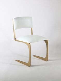 The Angel chair in Gold upholstered in white #leather