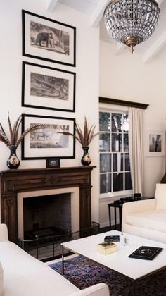 how to hang artwork on a tall wall with vaulted or cathedral ceiling. Shown on fireplace