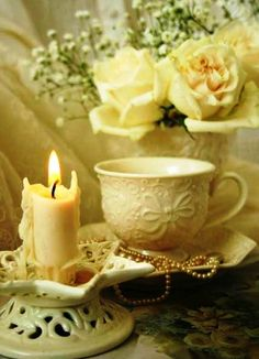 Love the yellow cup with the flowers and candle.