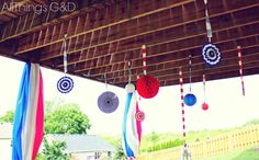 Red, white, and blue paper decorations hanging from our upper deck - Patriotic Backyard Fourth of July Party | www.allthingsgd.com