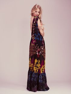 Bali Bali Dress | In a lightweight easy fabric, this handcrafted maxi dress features a colorful floral design with cutwork detailing. Easy, shapeless silhouette with a low V back.