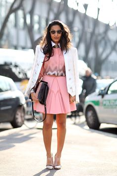 It's all about the accessories in this look. See-through shoes, a striped bag, and a stiff collar take this outfit to the next level.