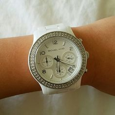 Michael Kors white ceramic watch White Michael Kors ceramic watch. Since it is ceramic, it is extremely durable and does not scratch easily. This watch glams up any look night or day.  Crystals are shiny and all are intact. Watch is in great condition! Extra links available to lengthen the watch. Box included. Michael Kors Accessories Watches