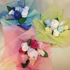 Baby Shower Bouquet beautifully arranged to include baby clothes and socks.