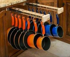 This is an interesting storage solution for pots and pans. The full extension slides allow you to take advantage of the cabinet depth and the hangers keep everything separated and easy to see. Design has come so far, imagine the convenience in your new kitchen!!