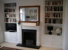 fireplace with fitted alcove cupboard / cabinet / shelvese cupboards
